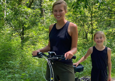 Smiling girls with e-bike